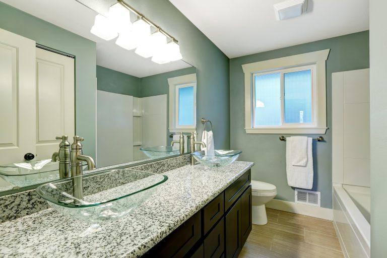 Modern,Bathroom,Interior,With,Window.,View,Of,Wooden,Vanity,Cabinet
